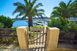 small wooden gate in Cannigione harbor